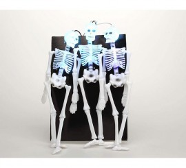 Colgante luminoso de 3 esqueletos de 54 x 23 cm.